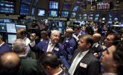 Dow briefly tops 18K for first time since July
