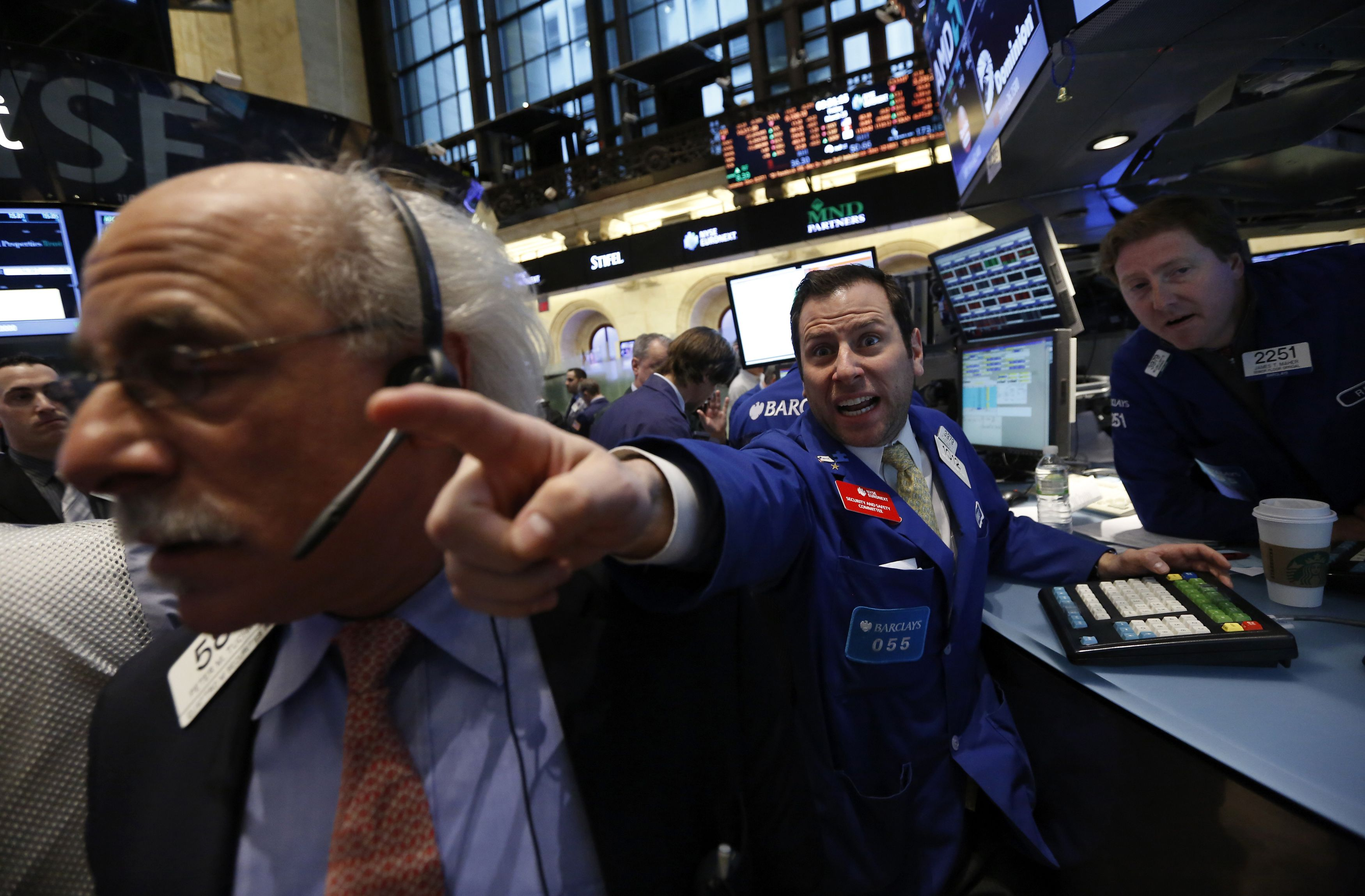Barclays specialist trader Michael Pistillo shouts out a price just after the opening bell on the floor at the New York Stock Exchange, March 15, 2013. REUTERS/Brendan McDermid (UNITED STATES - Tags: BUSINESS) - RTR3F1A6